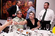 BETHLEHEM, PA &ndash; JUNE 17, 2011: Hispanic businessman Octavio Pena (left, seated) celebrates with his wife and friends at a cocktail party in Bethlehem, Pennsylvania.<br />
