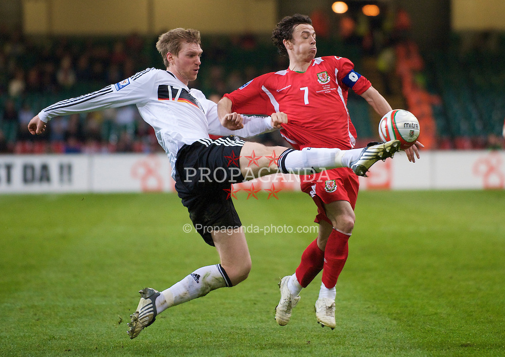 CARDIFF, WALES - Wednesday, April 1, 2009: Wales' captain Simon Davies and Germany's Per Mertesacker during the 2010 FIFA World Cup Qualifying Group 4 match at the Millennium Stadium. (Pic by David Rawcliffe/Propaganda)