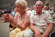 Aug, 25, 2009 -- SUN CITY, AZ: LIL SCHARENBRACH and her husband ROGER SCHARENBRACH cheer for Sen. John McCain during the Town Hall meeting on health care sponsored by Sen McCain at Grace Bible Church in Sun City, AZ, Tuesday. More than 1,000 people attended the meeting in the church, which seats 700. Sun City is a staunchly Republican suburb of Phoenix and most of the crowd was opposed to President Obama health care reform efforts.    Photo by Jack Kurtz / ZUMA Press