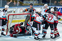 KELOWNA, BC - FEBRUARY 15: Referee Matt Hicketts blows the whistle after Cameron Hausinger #10 of the Red Deer Rebels falls over Roman Basran #30 of the Kelowna Rockets during third period at Prospera Place on February 15, 2020 in Kelowna, Canada. (Photo by Marissa Baecker/Shoot the Breeze)