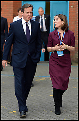 Image ©Licensed to i-Images Picture Agency. 28/09/2014. Birmingham, United Kingdom. The Prime Minister David Cameron with a candidate on  Day one of the  Conservative Party Conference.Picture by Andrew Parsons / i-Images