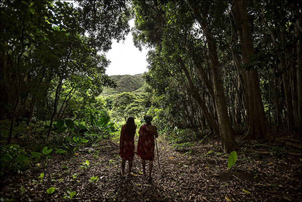 Anakala Pilipo Solatario and his son Gregory confer during a walk in Halawa Valley near the home. ©PF Bentley