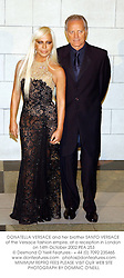 DONATELLA VERSACE and her brother SANTO VERSACE of the Versace fashion empire, at a reception in London on 14th October 2002.PEA 253