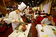 Qianmen Quanjude Roast Duck Restaurant - the best Beijing Roast Duck since 1864. The chefs are slicing up the ducks within seconds at the guests' table.
