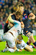 Pierre Schoeman (#1) of Edinburgh Rugby is tackled by Ryan Wilson (#8) of Glasgow Warriors during the 1872 Cup second leg Guinness Pro14 2019_20 match between Edinburgh Rugby and Glasgow Warriors at BT Murrayfield Stadium, Edinburgh, Scotland on 28 December 2019.