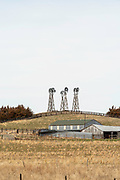 Windmills dot the skyline on a ranch in western Nebraska, north of Scottsbluff.