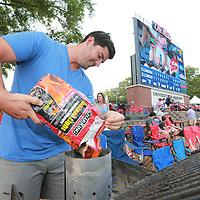 Kyle Thornton of Oxford  gets his grill started in ledft field before the Ole Miss game against Jaksonville State Friday in Oxford.