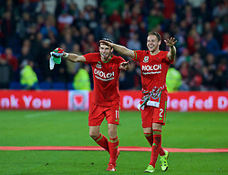 CARDIFF, WALES - Tuesday, October 13, 2015: Wales' Gareth Bale and Chris Gunter celebrate qualifying for the finals after the 2-0 victory over Andorra during the UEFA Euro 2016 qualifying Group B match at the Cardiff City Stadium. (Pic by Barry Coombs/Propaganda)
