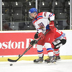 COBOURG, - Dec 18, 2015 -  WJAC Game 11- Team Czech Republic vs Team Switzerland at the 2015 World Junior A Challenge at the Cobourg Community Centre, ON. Michal Furch #15 of Team Czech Republic battles for control during the first period.<br /> (Photo: Andy Corneau / OJHL Images)