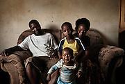 Nyachuru Secondary School, Zimbabwe. November, 2012. Forbes Chingono, Kuzivaishe (11 months), Gladys Gwarada and Tinonashe. Forbes and Gladys teach at Nyachuru Secondary School.