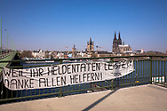 Coronavirus / Covid 19 outbreak, April 8th. 2020. A banner at the Deutzer bridge thanks the helpers, view to the cathedral, Cologne, Germany.<br /> <br /> Coronavirus / Covid 19 Krise, 8. April 2020. Ein Banner an der Deutzer Bruecke dankt den Helfern, Blick zum Dom, Koeln, Deutschland.