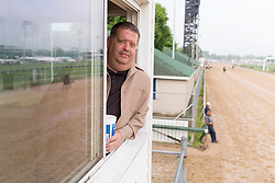 Dale Romans trainer of Blue Grass Stakes Winner and Derby 142 hopeful Brody's Cause watches horses train, Sunday, May 01, 2016 at Churchill Downs in Louisville.