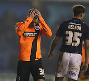 Joe Bennett, Brighton defender missed chance during the Sky Bet Championship match between Millwall and Brighton and Hove Albion at The Den, London, England on 17 March 2015.