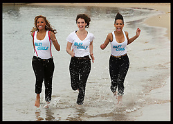 Actress's Lorraine Burroughs, Lily James and Dominique Tipper run along the beach at the Cannes Film Festival  to promote their new film Fast Girls about  a group of female athletes hoping to compete at the 2012 Olympics. Friday 18th, May 2012.Photo by: Stephen Lock / i-Images