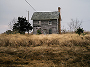 A vacant home in Hoopersville, MD decays in the expaning marsh on Dec. 30, 2017. With property values dropping along the most vulnerable areas on the Eastern Shore, some homes are left for the saturated soil to recalim.