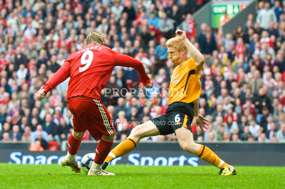 LIVERPOOL, ENGLAND - Saturday, September 26, 2009: Liverpool's Fernando Torres completes his hat-trick, scoring his side's third goal against Hull City, during the Premiership match at Anfield. (Photo by: David Rawcliffe/Propaganda)