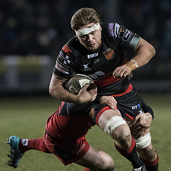 Lewis Evans of the Dragons is tackled by Edinburghs' Bill Mata.<br /> <br /> Photographer Simon Latham/Replay Images<br /> <br /> Guinness PRO14 - Dragons v Edinburgh - Friday 23rd February 2018 - Eugene Cross Park - Ebbw Vale<br /> <br /> World Copyright © Replay Images . All rights reserved. info@replayimages.co.uk - http://replayimages.co.uk