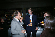 Simon Critchell and Ben Elliot. Party to celebrate Alfred Dunhill at the Goodwood Festival of Speed. Dunhill shop. 48 Jermyn St. London SW1. 9 June 2005. ONE TIME USE ONLY - DO NOT ARCHIVE  © Copyright Photograph by Dafydd Jones 66 Stockwell Park Rd. London SW9 0DA Tel 020 7733 0108 www.dafjones.com