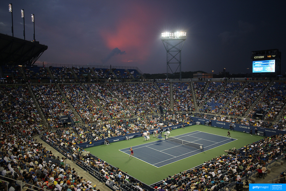 Venus Williams, USA, and Jie Zheng, China, in action during sunset over Louis Armstrong Stadium during the Women's Singles competition at the US Open. Flushing, New York, USA. 28th August 2013. Photo Tim Clayton