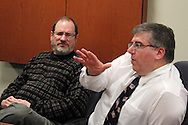 Steve Watring of Kettering (left) and Dr. Tony Corvo of Beavercreek during a roundtable discussion of the Republican debate in Arizona, Wednesday, February 22, 2012.