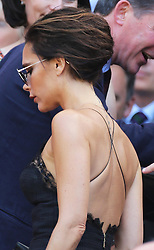 Victoria Beckham  takes her seat in the Royal Box for the Men's Final at the Wimbledon Tennis Championships in  London, Sunday, 7th July 2013<br /> Picture by Stephen Lock / i-Images