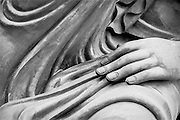 Detail of a statue representing a goddess. She is resting her hand on her knee, near the great Buddha of the island of Lantau, Hong Kong, 2001.