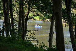 GRUNDHOF, LUXEMBOURG - SEPT-9-2012 - The bike path in Gundhof, follows the Sure river, where canoeists can been seen paddling by. (Photo © Jock Fistick)