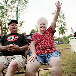 Kyle Green | The Roanoke Times<br /> 7/2/2011 Land owners raise their hands and shout &quot;White Power&quot; during a  Rebel Brigade KKK meeting and cross burning in Martinsville, Virginia. The KKK is making a comeback in the USA helped by high unemployment and a growing distrust in the government.