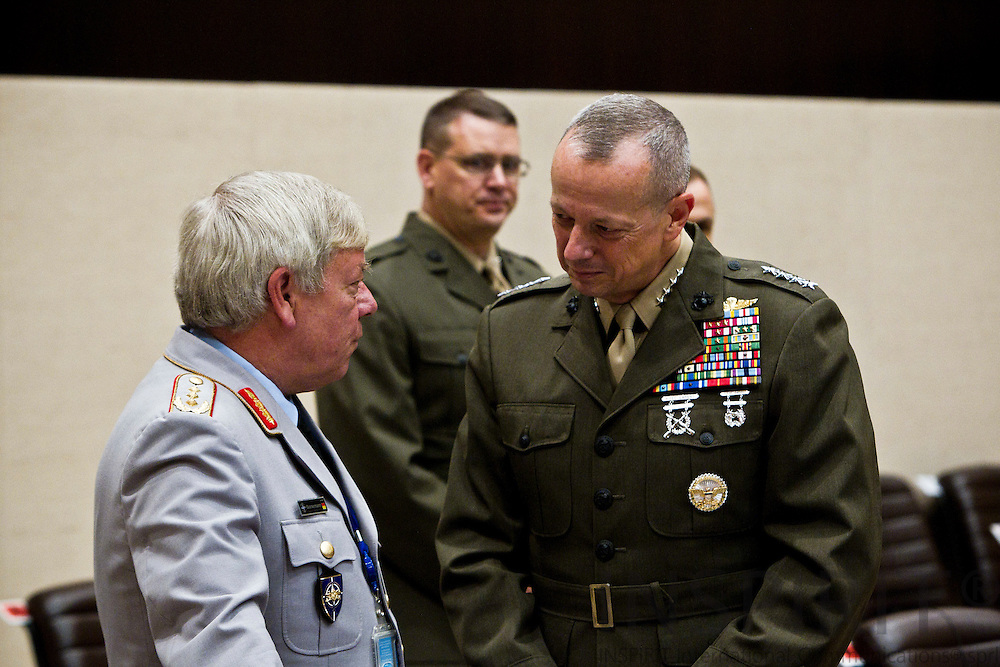 From left Lieutenant General Jürgen Bornemann, Military Representative of Germany, talking with General John R. Allen, Commander of ISAF, at the beginning of the NATO defence ministers meeting at the alliance headquarters in Brussels October 6, 2011. PHOTO: ERIK LUNTANG / INSPIRIT Photo.