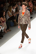 Mn's pants with elastic cuffed hems, bright printed T and print jacket. By Custo Barcelona at the Spring 2013 Fashion Week show in New York.