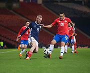 23rd March 2018, Hampden Park, Glasgow, Scotland; International Football Friendly, Scotland versus Costa Rica; Oli McBurnie of Scotland takes on David Guzman of Costa Rica