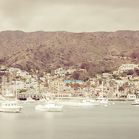 Catalina Island Avalon Bay retro panorama photo with boats, mountains, and hillside buildings. Santa Catalina Island is a popular vacation and travel destination off the coast of California in the United States.