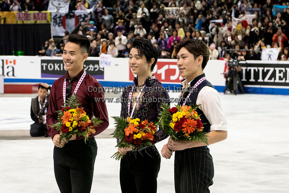 KELOWNA, BC - OCTOBER 26: Mens long program gold medalist, Japanese skater Yuzuru Hanyu (c), silver medalist, Canadian figure skater Nam Nguyen (l) and bronze medalist, Japanese skater Keiji Tanaka (r) stand on the ice at Prospera Place on October 26, 2019 in Kelowna, Canada. (Photo by Marissa Baecker/Shoot the Breeze)