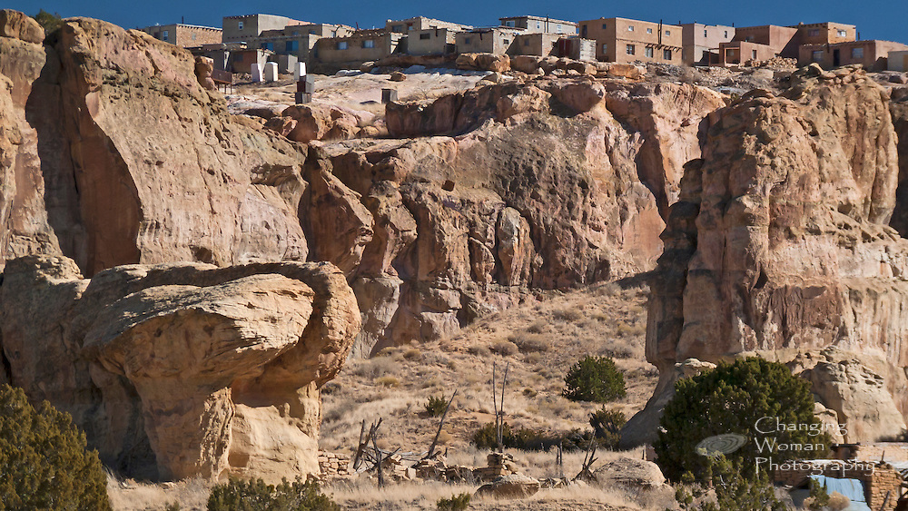 Massive boulders and vertical cliff walls helped protect ancient Sky City from Spanish destruction.  The price in daily life activities was high: every building stone, ladder or fire log, and gallon of water people used had to be carried by hand up to the mesa top.