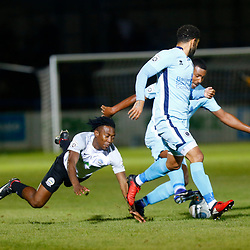 SEPTEMBER 12:  Top of the table Dover Athletic FChost eighth place Boreham Wood FC in Conference Premier at Crabble Stadium in Dover, England. The visitors, Boreham Wood  ran out winners a goal to nothing. Dover's forward Tobi Sho-Silva gets muscled off the ball by two Boreham Wood players. 1(Photo by Matt Bristow/mattbristow.net)
