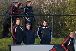 KIRKBY, ENGLAND - Tuesday, November 16, 2010: Liverpool's assistant manager Sammy Lee and Director of Football Strategy Damien Comolli watch the reserves take on Blackpool during the FA Premiership Reserves League (Northern Division) match at the Kirkby Academy. (Pic by: David Rawcliffe/Propaganda)