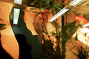 Switzerland, Uzwil, Health Balance clinic for animals....Mr. Urs Bühler, the founder of the centre, a therapist and a noted..industrialist in the area, stands in front of the aquarium housing the..clinic's smallest patient: a goldfish suffering from the effects of..electromagnetic pollution... The goldfish swims lazily between the fronds of fake seaweed, under the attentive gaze of the medical staff. ?When he came here he was moving all wrong. He swam crooked, he was almost upside-down,? explains Marisa Polanec, obviously enthusiastic at the result. For it appeared that the littlest in-patient at Health Balance, the Swiss clinic for animals, had been suffering from electrosmog poisoning. ..An unusual complaint, yes, but here, in the midst of the clinic?s futuristic architecture and the green hills of San Gallo canton, the concept of normality is done away with even before arriving at a diagnosis. That?s because, to identify the cause of the goldfish?s suffering, Urs Buehler ?kinesiologist and the centre?s founder, as well as the owner of an industrial colossus in the region ?simply asked it, by using his ever-present dowsing rod. .. The goldfish swims lazily between the fronds of fake seaweed, under the attentive gaze of the medical staff. ?When he came here he was moving all wrong. He swam crooked, he was almost upside-down,? explains Marisa Polanec, obviously enthusiastic at the result. For it appeared that the littlest in-patient at Health Balance, the Swiss clinic for animals, had been suffering from electrosmog poisoning. ..An unusual complaint, yes, but here, in the midst of the clinic?s futuristic architecture and the green hills of San Gallo canton, the concept of normality is done away with even before arriving at a diagnosis. That?s because, to identify the cause of the goldfish?s suffering, Urs Buehler ?kinesiologist and the centre?s founder, as well as the owner of an industrial colossus in the region ?simply asked it, by using his ever-present dowsing r