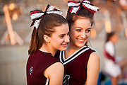 23 SEPTEMBER 2011 - SCOTTSDALE, AZ: Alexa Wheeler (CQ) LEFT and Lexi McNevin (CQ), both sophomore members of the pom squad, pose for pictures before the game at Desert Mountain High School in Scottsdale. Desert Mountain played Notre Dame in Desert Mountain's homecoming high school football game.    PHOTO BY JACK KURTZ