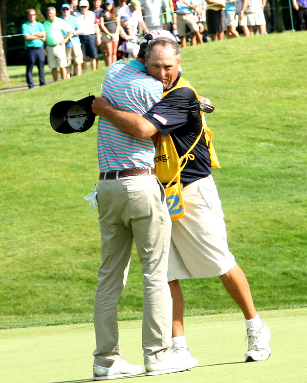 Chesson Hadley hugs his caddy after winning the LeCom Health Challenge Web.com PGA Tour at Peek n Peak July 9, 2017 photo by Mark L. Anderson