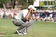 Jul 30, 2005; Grand Blanc, MI, USA; Tiger Woods eyes his birdie putt on the eighteenth hole at the end of play Saturday at Warwick Hills Golf & Country Club during the 2005 Buick Open.  Copyright © 2005 Kevin Johnston