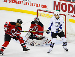 Nov 5, 2008; Newark, NJ, USA; New Jersey Devils goalie Kevin Weekes (1) makes a save while Tampa Bay Lightning center Vincent Lecavalier (4) and New Jersey Devils defenseman Bryce Salvador (24) battle in front of the goal during the overtime period at the Prudential Center.