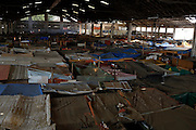 """Makeshift homes, part of the Nova Tuffy slum, are pictured in an abandoned factory in Rio de Janeiro, October 17, 2014. Since seven months ago, 1,800 families have been living inside the factory, which they occupied in March, with poor sanitation services and the fear of eviction. The occupants of the factory say they are not included in the housing program """"Minha Casa, Minha Vida"""" (My House, My Life), and they would like to be included by the Brazilian government. The housing program is one of several government initiatives aimed at reducing poverty and social inequality that President Dilma Rousseff has held up as achievements of her administration as she campaigns for re-election. Photo/Pilar Olivares"""