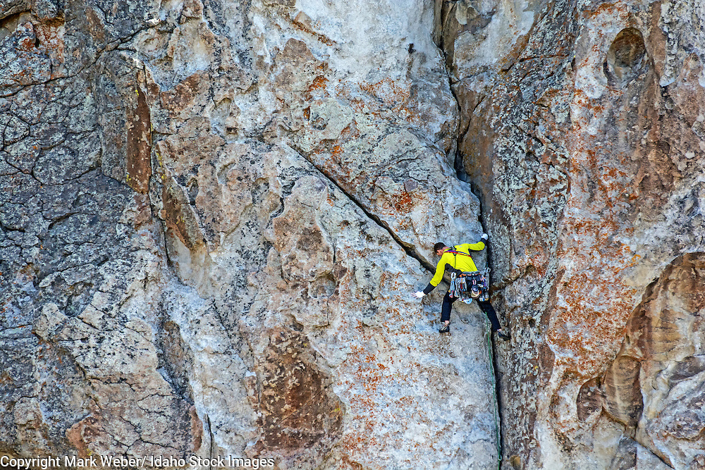 Elijah Weber rock climbing a route called Private Idaho which is rated 5,9 and located on Bath Rock at the City Of Rocks National Reserve near the town of Almo in southern Idaho