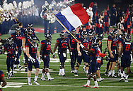 TUCSON, AZ - NOVEMBER 14:  Cornerback DaVonte' Neal #19 of the Arizona Wildcats waves the French flag prior to the game against the Utah Utes at Arizona Stadium on November 14, 2015 in Tucson, Arizona.  (Photo by Jennifer Stewart/Getty Images)