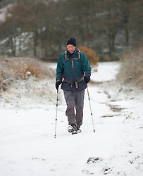 © Licensed to London News Pictures. 05/12/2012..Yorkshire and Cleveland, England..Overnight snow fall brings the first signs of the wintery weather that is forecast for the rest of this week to Roseberry Topping in North Yorkshire as a walker walks makes his way along a track at the base...Photo credit : Ian Forsyth/LNP