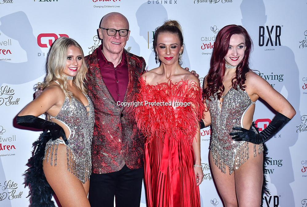 John Caudwell,Modesta Vzesniauskaite arrive at Float Like A Butterfly Ball for Caudwell Children Charity at Grosvenor House Hotel on 16 November 2019, London, UK.