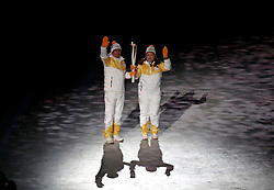 Torchbearers with the Olympic flame during the Opening Ceremony of the PyeongChang 2018 Winter Olympic Games at the PyeongChang Olympic Stadium in South Korea.