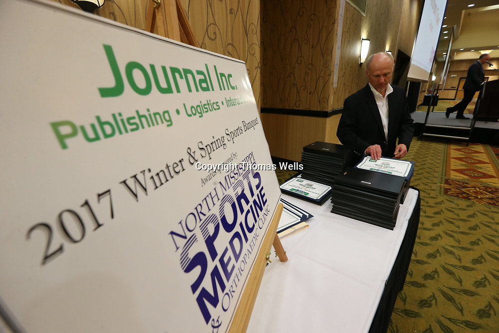 Northeast Mississippi Daily Journal General manager Danny Smith gets ready to present the next award during Monday's 2017 Winter & Sring Sports Banquet at the BancorpSouth Conference Center.