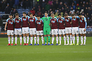 Burnley players observe a minutes silence for friends of Burnley FC lost in 2018  during the Premier League match between Burnley and Fulham at Turf Moor, Burnley, England on 12 January 2019.