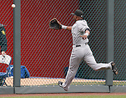 Chicago White Sox left fielder Alejandro De Aza is unable to reach a fly ball hit by Kansas City Royals' Jeff Francoeur in the fifth inning of a baseball game against the at Kauffman Stadium in Kansas City, Mo., Sunday, May 5, 2013.  (AP Photo/Colin E. Braley).